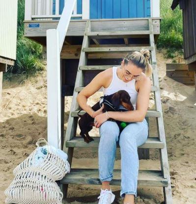 Natalie and her dog on the beach